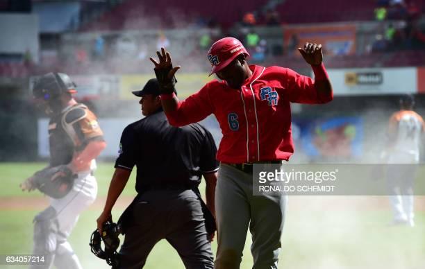 Ruben Gotay of Criollos de Caguas of Puerto Rico celebrates after scoring during a Caribbean Baseball Series match against Aguilas del Zulia of...