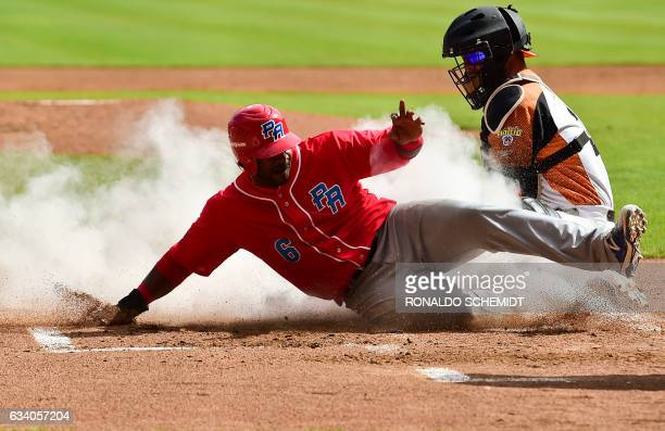 Ruben Gotay of Criollos de Caguas of Puerto Rico slides safe in home during a Caribbean Baseball Series match against Aguilas del Zulia of Venezuela...