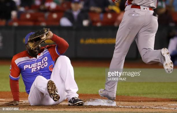 Ruben Gotay of Criollos de Caguas of Puerto Rico tags out on first base to Yefri Perez of Aguilas Cibaenas of Republica Dominicana during the final...