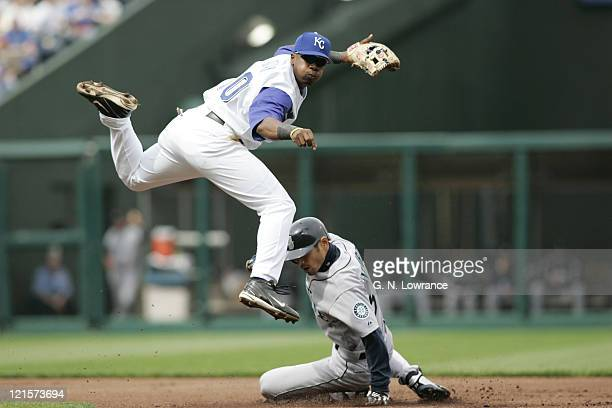 Ruben Gotay of the Kansas City Royals completes a double play as Ichiro Suzuki of the Seattle Mariners slides in during a game at Kauffman Stadium on...
