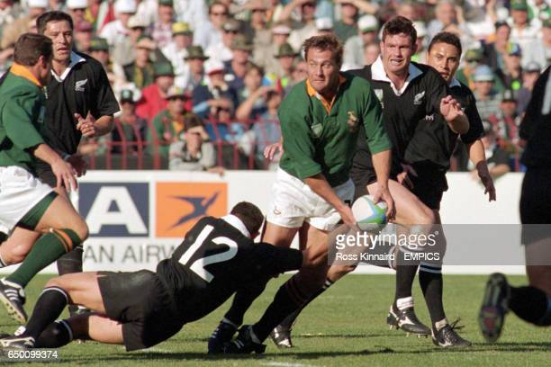 Ruben Kruger SA is tackled by Walter Little NZ