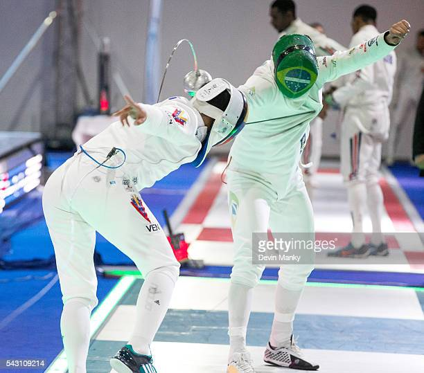 Ruben Limardo Gascon of Venezuela makes an attack against Nicolas Ferreira of Brazil and is touched in return during Team Men's Epee competition at...