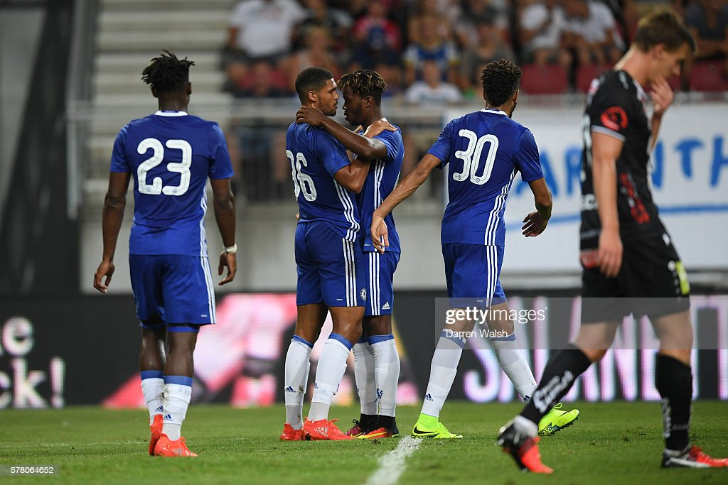 Ruben Loftus Cheek of Chelsea is congratulated by teammates Nathaniel Chalobah of Chelsea after scoring his team's second goal during the pre season friendly match between WAC RZ Pellets and Chelsea FC at the Worthersee Stadion on July 20, 2016 in Klagenfurt, Austria.