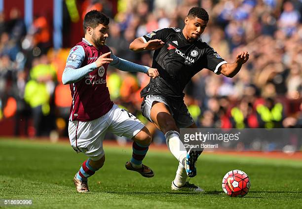 Ruben LoftusCheek of Chelsea and Carles Gil of Aston Villa compete for the ball during the Barclays Premier League match between Aston Villa and...