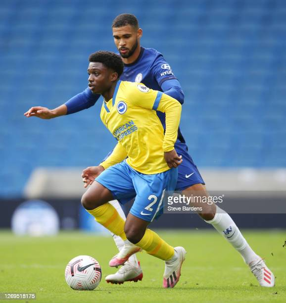 Ruben LoftusCheek of Chelsea and Tariq Lamptey of Brighton and Hove Albion battle for the ball during the preseason friendly between Brighton Hove...