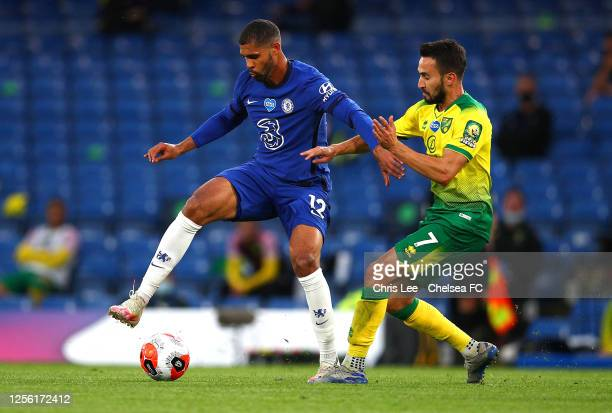 Ruben LoftusCheek of Chelsea battle for possession Patrick Roberts of Norwich City during the Premier League match between Chelsea FC and Norwich...
