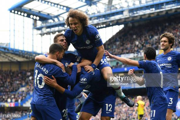 Ruben LoftusCheek of Chelsea celebrates as he scores his team's first goal with David Luiz and team mates during the Premier League match between...