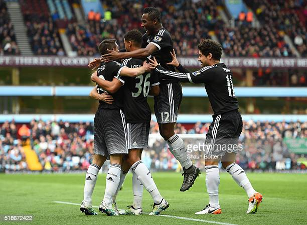 Ruben LoftusCheek of Chelsea celebrates scoring his team's first goal with his team mates Cesar Azpilicueta John Mikel Obi and Alexandre Pato during...