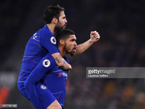 Ruben LoftusCheek of Chelsea celebrates scoring the opening goal with Cesc Fabregas during the Premier League match between Wolverhampton Wanderers...