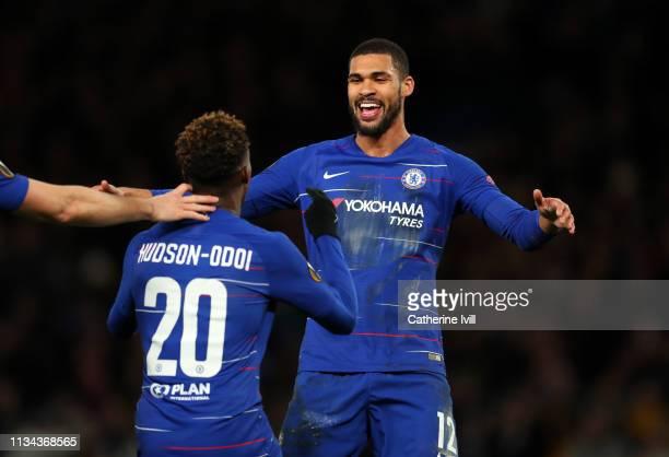 Ruben LoftusCheek of Chelsea celebrates with Callum HudsonOdoi of Chelsea during the UEFA Europa League Round of 16 First Leg match between Chelsea...