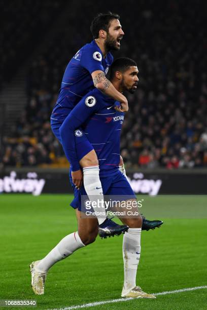 Ruben Loftus-Cheek of Chelsea celebrates with teammate Cesc Fabregas after scoring his team's first goal during the Premier League match between...