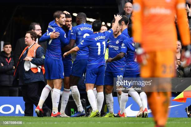 Ruben LoftusCheek of Chelsea celebrates with teammates after scoring his team's second goal during the Premier League match between Chelsea FC and...