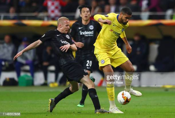 Ruben LoftusCheek of Chelsea evades Sebastian Rode of Eintracht Frankfurt during the UEFA Europa League Semi Final First Leg match between Eintracht...