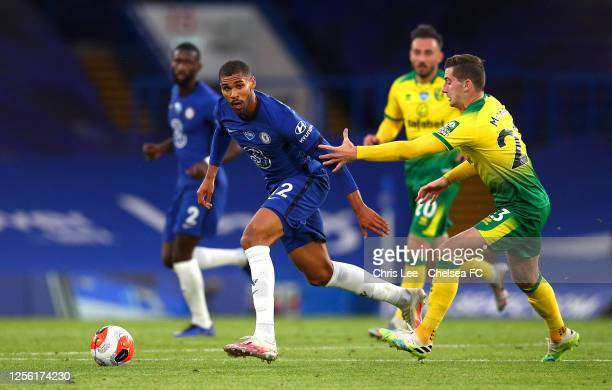Ruben LoftusCheek of Chelsea holds off Kenny McLean of Norwich City during the Premier League match between Chelsea FC and Norwich City at Stamford...