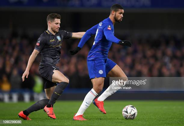 Ruben LoftusCheek of Chelsea is challenged by Sam Hutchinson of Sheffield Wednesday during the FA Cup Fourth Round match between Chelsea and...