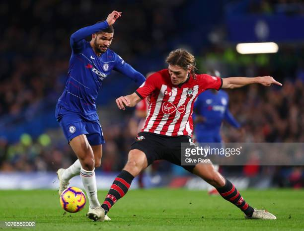 Ruben LoftusCheek of Chelsea is tackled by Jannik Vestergaard of Southampton during the Premier League match between Chelsea FC and Southampton FC at...