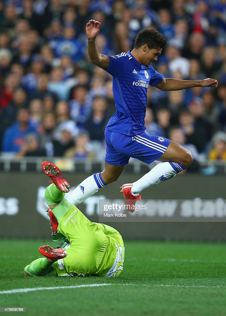 Ruben Loftus-Cheek of Chelsea jumps over a diving Vedran Janjetovic of Sydney FC during the international friendly match between Sydney FC and Chelsea FC at ANZ Stadium on June 2, 2015 in Sydney, Australia.
