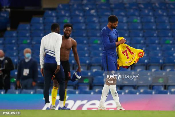 Ruben Loftus-Cheek of Chelsea looks at Nathaniel Chalobah of Watford shirt after swapping it after the Premier League match between Chelsea FC and...