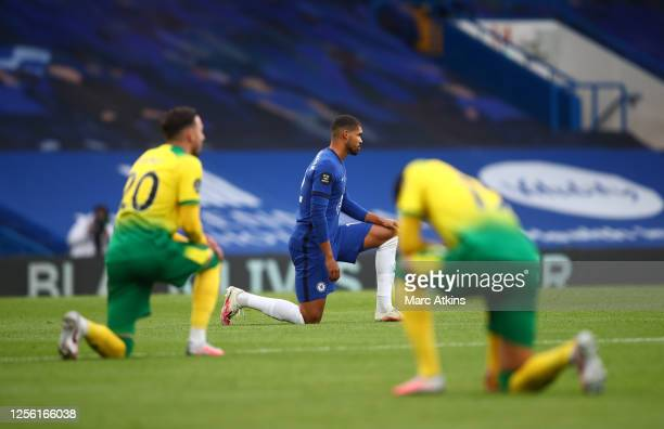 Ruben LoftusCheek of Chelsea takes a knee in support of the Black Lives Matter movement ahead of the Premier League match between Chelsea FC and...