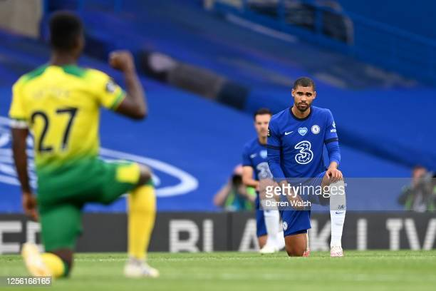 Ruben LoftusCheek of Chelsea takes a knee in support of the Black Lives Matter movement prior to the Premier League match between Chelsea FC and...