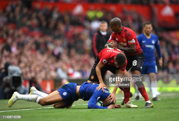 Ruben Loftus-Cheek of Chelsea tangles with Ander Herrera and Ashley Young of Manchester United during the Premier League match between Manchester...