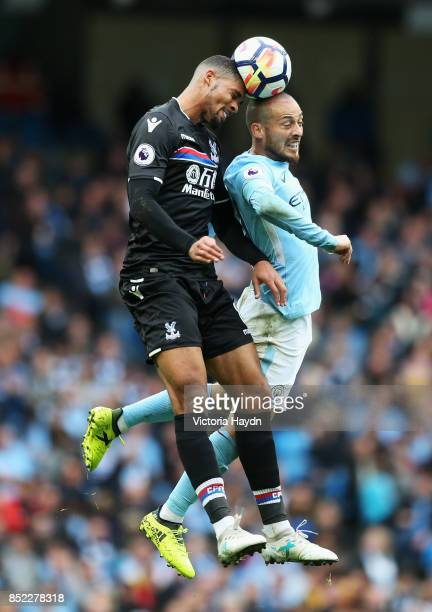 Ruben LoftusCheek of Crystal Palace and David Silva of Manchester City battle for possession in the air during the Premier League match between...