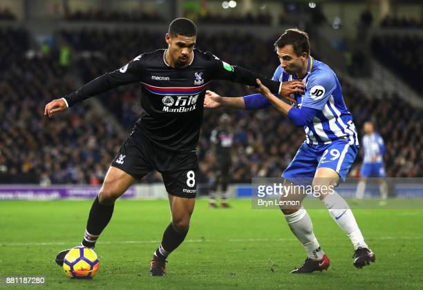 Ruben LoftusCheek of Crystal Palace and Markus Suttner of Brighton and Hove Albion during the Premier League match between Brighton and Hove Albion...