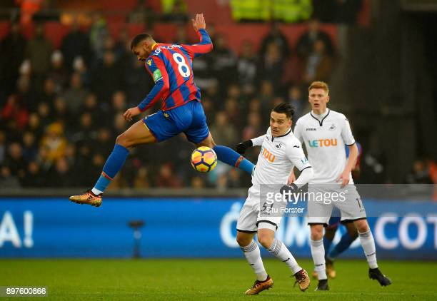 Ruben LoftusCheek of Crystal Palace attempts to win a header as Roque Mesa of Swansea City looks on during the Premier League match between Swansea...