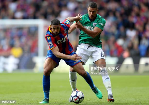Ruben LoftusCheek of Crystal Palace battles for possession with Jake Livermore of West Bromwich Albion during the Premier League match between...