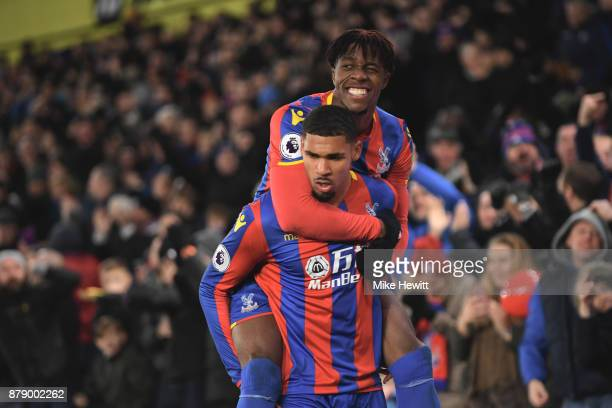 Ruben LoftusCheek of Crystal Palace celebrates scoring his sides first goal with Wilfried Zaha of Crystal Palace during the Premier League match...