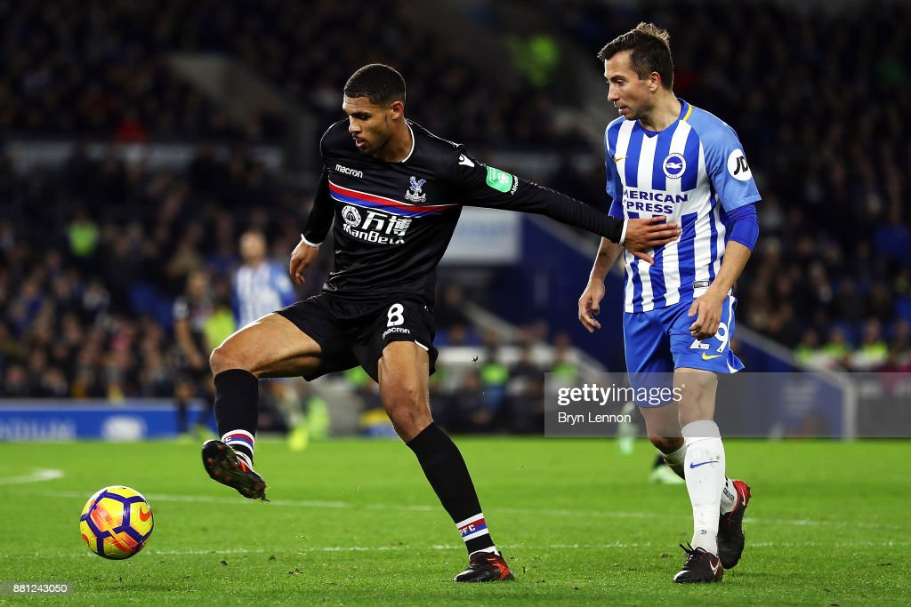 Ruben Loftus-Cheek of Crystal Palace holds back Markus Suttner of Brighton & Hove Albion during the Premier League match between Brighton and Hove Albion and Crystal Palace at Amex Stadium on November 28, 2017 in Brighton, England.