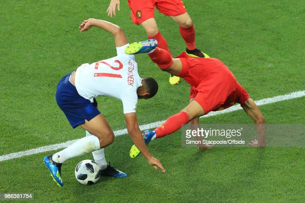 Ruben LoftusCheek of England muscles Leander Dendoncker of Belgium out of the way during the 2018 FIFA World Cup Russia Group G match between England...