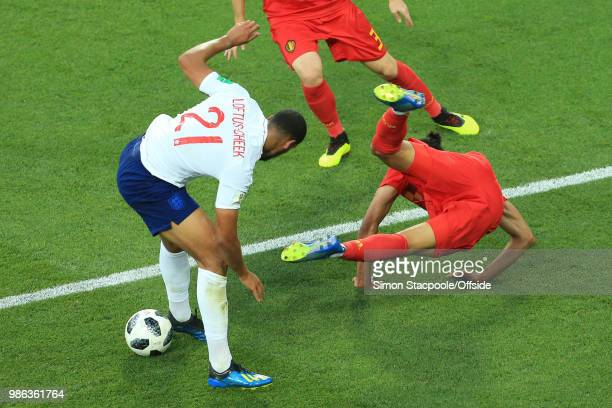 Ruben Loftus-Cheek of England muscles Leander Dendoncker of Belgium out of the way during the 2018 FIFA World Cup Russia Group G match between...