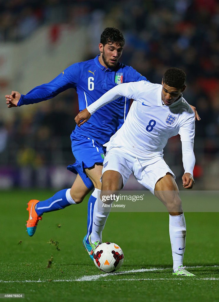 Ruben Loftus-Cheek of England U19 beats Arturo Calabresi of Italy U19 during the International friendly match between England U19 and Italy U19 at The New York Stadium on November 14, 2014 in Rotherham, England.