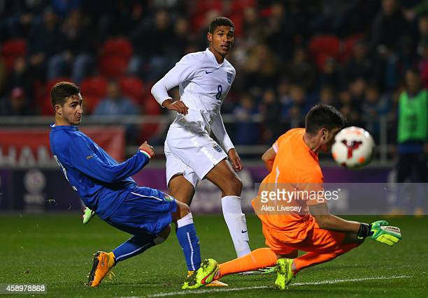 Ruben LoftusCheek of England U19 beats Simone Scuffet of Italy U19 to score the third goal during the International friendly match between England...