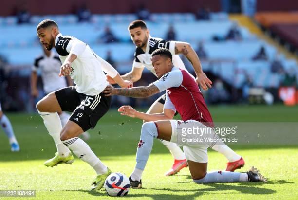 Ruben Loftus-Cheek of Fulham and Ezri Konsa Ngoyo of Aston Vila during the Premier League match between Aston Villa and Fulham at Villa Park on April...