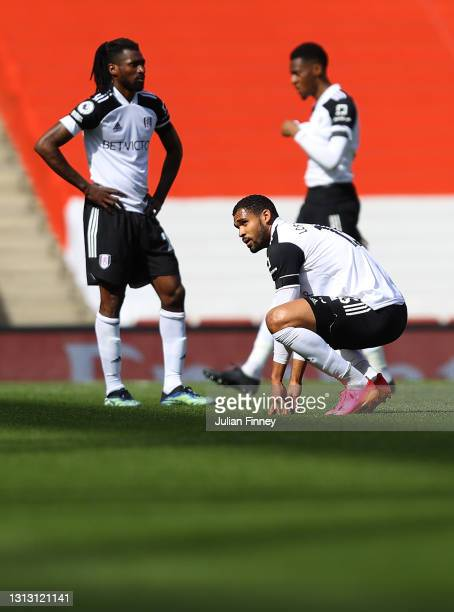 Ruben Loftus-Cheek of Fulham and teammates look dejected following the Premier League match between Arsenal and Fulham at Emirates Stadium on April...