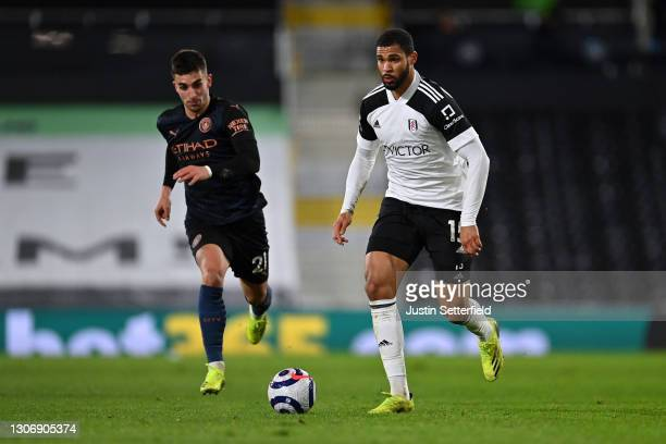 Ruben Loftus-Cheek of Fulham battles for possession with Ferran Torres of Manchester City during the Premier League match between Fulham and...