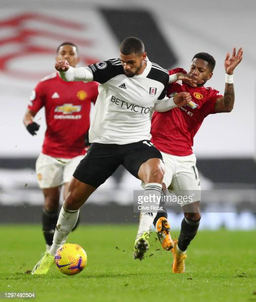 Ruben Loftus-Cheek of Fulham battles for possession with Fred of Manchester United during the Premier League match between Fulham and Manchester...
