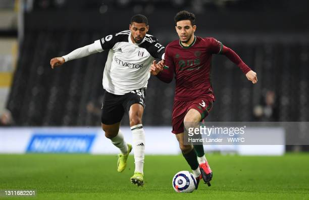Ruben Loftus-Cheek of Fulham battles for possession with Rayan Ait-Nouri of Wolverhampton Wanderers during the Premier League match between Fulham...