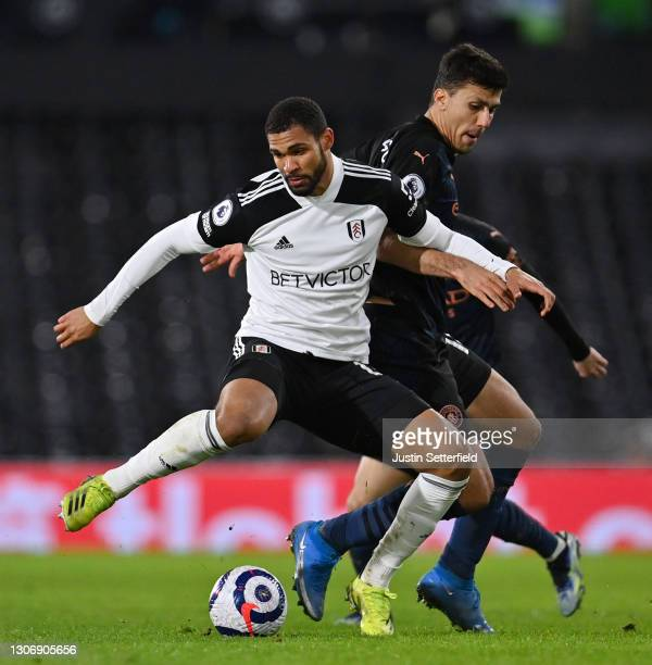 Ruben Loftus-Cheek of Fulham battles for possession with Rodrigo of Manchester City during the Premier League match between Fulham and Manchester...