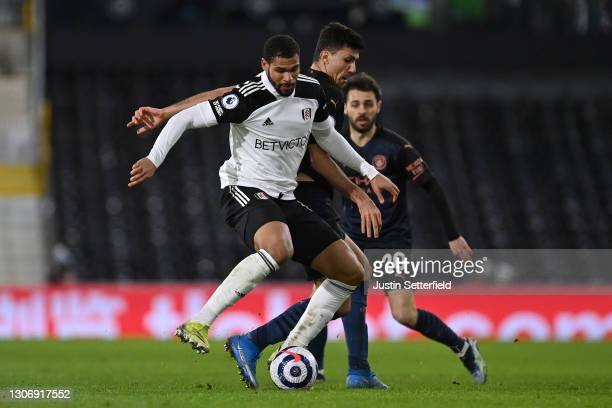 Ruben Loftus-Cheek of Fulham holds off Rodri of Manchester City during the Premier League match between Fulham and Manchester City at Craven Cottage...