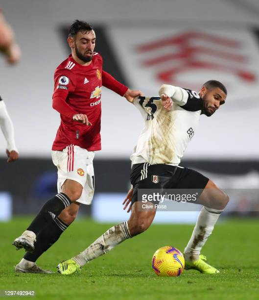 Ruben Loftus-Cheek of Fulham is challenged by Bruno Fernandes of Manchester United during the Premier League match between Fulham and Manchester...