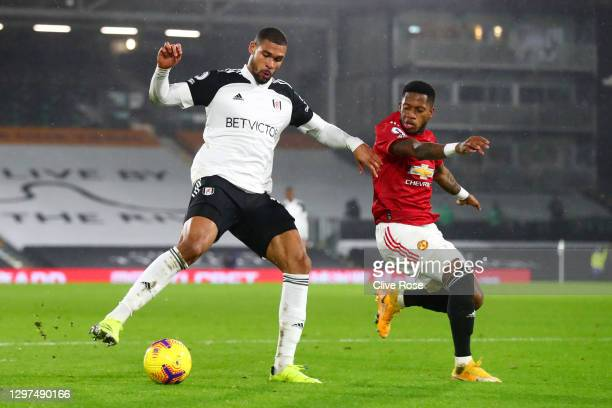 Ruben Loftus-Cheek of Fulham is challenged by Fred of Manchester United during the Premier League match between Fulham and Manchester United at...