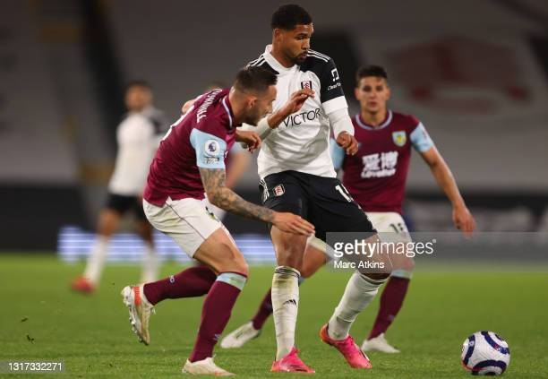 Ruben Loftus-Cheek of Fulham is challenged by Josh Brownhill of Burnley during the Premier League match between Fulham and Burnley at Craven Cottage...