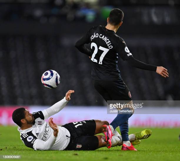 Ruben Loftus-Cheek of Fulham tackles Joao Cancelo of Manchester City during the Premier League match between Fulham and Manchester City at Craven...