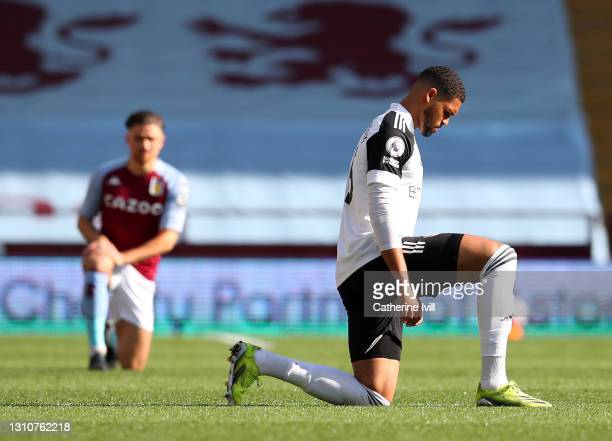 Ruben Loftus-Cheek of Fulham takes a knee in support of the 'Black Lives Matter' movement prior to the Premier League match between Aston Villa and...