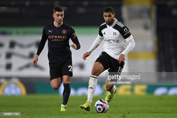 Ruben Loftus-Cheek of Fulham takes on Ferran Torres of Manchester City during the Premier League match between Fulham and Manchester City at Craven...