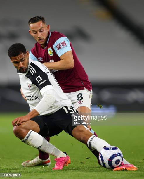 Ruben Loftus-Cheek of Fulham tangles with Josh Brownhill of Burnley during the Premier League match between Fulham and Burnley at Craven Cottage on...
