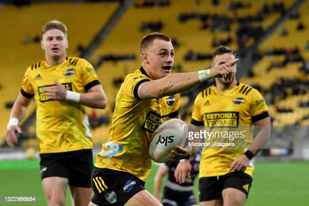 Ruben Love of the Hurricanes celebrates after scoring a try during the round five Super Rugby Trans-Tasman match between the Hurricanes and the...
